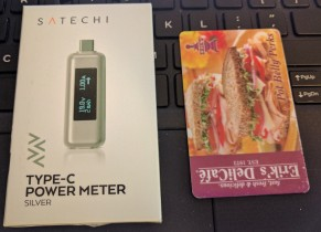 The Satechi Type-C power meter, with credit-card-sized card for scale